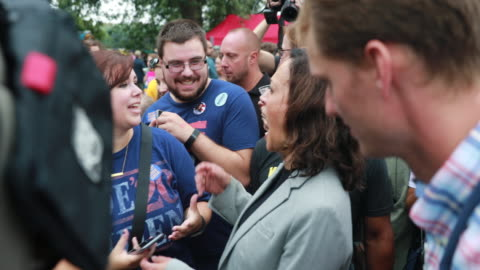 kamala harris, who is running for the democratic nomination for president, speaks to a supporter during the polk county steak fry in des moines,... - nomination stock videos & royalty-free footage