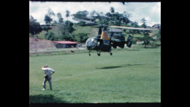 Kaman HH43 Huskie US Marine helicopter lands in field men get in From the home movie collection of Jack Dennis Boles Boles spent 17 years in the...