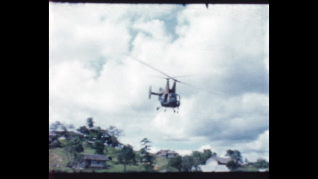 Kaman HH43 Huskie US Marine helicopter takes of from field in British North Borneo From the home movie collection of Jack Dennis Boles Boles spent 17...