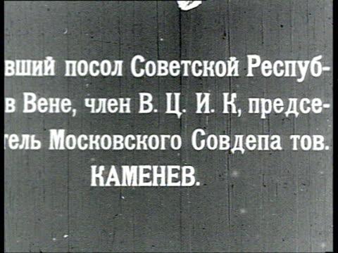 vidéos et rushes de kamenev reads some papers smokes cigarette / russia - 1918
