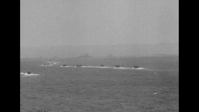 kamikaze attack japan / uss saratoga aircraft carrier at sea, sky above filled with flak / japanese plane shot down and crashing into water / qs... - carrying stock videos & royalty-free footage