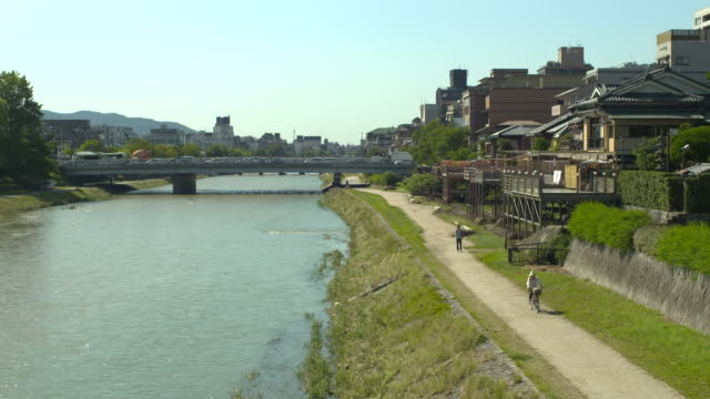 kamogawa river and bridge, kyoto, japan - riverbed stock videos & royalty-free footage
