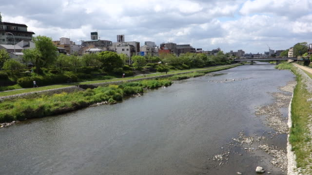 kamogawa river landscape, kyoto, japan - kyoto temple stock videos and b-roll footage