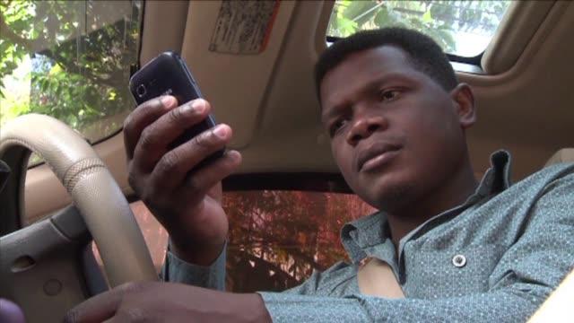 kampala uganda importa todo su petroleo y el combustible sale caro. voiced : ahorro por telefono en uganda on september 24, 2012 in kampala, uganda - kampala stock videos & royalty-free footage