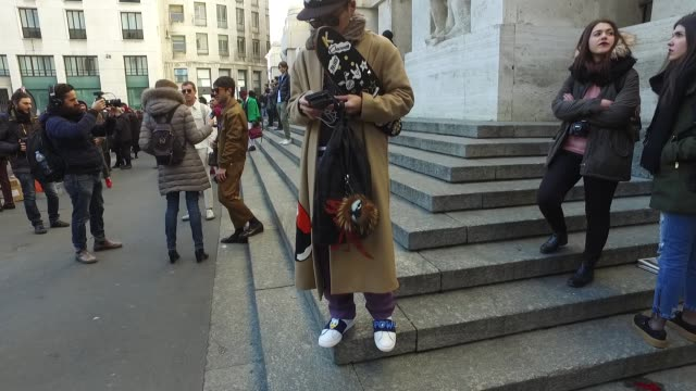 Kaname Murakami is wearing a MSGM coat Zara top Master of arts shoes Cos pants and Doublet x Newnue collaboration bag on January 15 2017 in Milan...