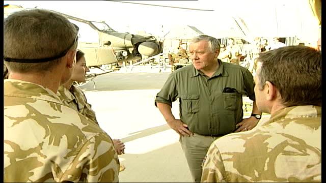 adam ingram visits british troops; afghanistan: kandahar: ext vars adam ingram mp greeting and chatting with british troops at army base - kandahar stock-videos und b-roll-filmmaterial