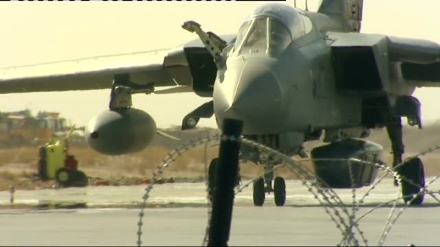 kandahar: ext various views of panavia tornado fighter bomber landing at airport including close shot of 'raptor pod' which takes aerial photographs... - kandahar stock-videos und b-roll-filmmaterial