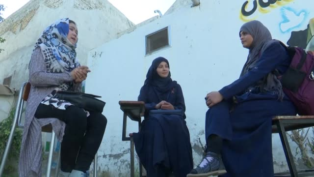 kandahar schoolgirls discuss a potential taliban comeback speaking ahead of the us's historic accord with the militants - discussion stock videos & royalty-free footage