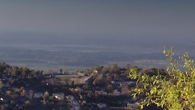kangra valley, dharamsala.the mountainous, tree-covered landscape with homes nestled into the lush mountain-side. - pinaceae stock videos & royalty-free footage