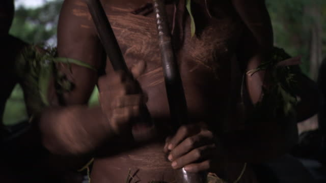 Kaningara crocodile man drums during initiation scarring ceremony, Sepik, PNG