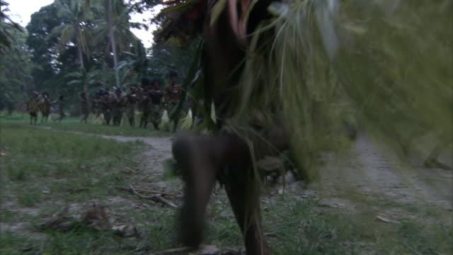 kaningara crocodile people perform at initiation ceremony, sepik, png  - menschliche gliedmaßen stock-videos und b-roll-filmmaterial