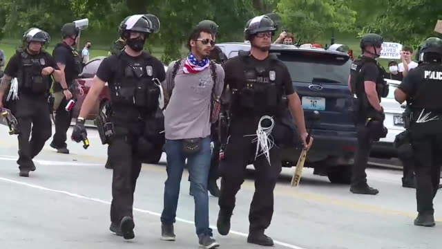 kansas city, mo, u.s. - police detaining protestors during george floyd protests on saturday, may 30, 2020. - confrontation stock videos & royalty-free footage