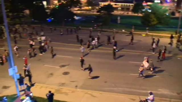 kansas city, mo, u.s. - police using gas on gathering protestors during george floyd protests on sunday, may 31, 2020. - confrontation stock videos & royalty-free footage