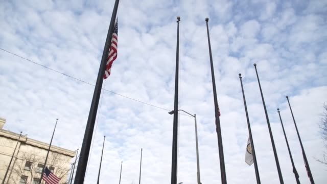 kansas governor sam brownback ordered flags in kansas be lowered from sunrise to sundown on friday to honor victims and families of the hesston... - kansas city kansas stock videos & royalty-free footage