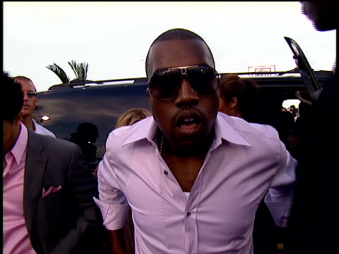 Kanye West and John Legend are getting out of their limo and walking on the 2004 MTV Video Music Awards red carpet