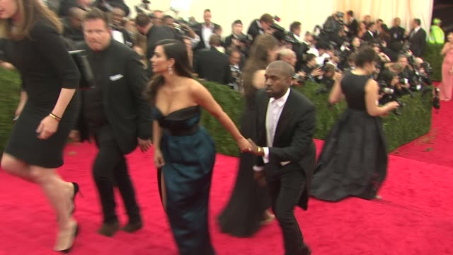 kanye west and kim kardashian at charles james beyond fashion costume institute gala arrivals at the metropolitan museum on may 05 2014 in new york... - gala stock videos & royalty-free footage