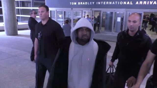 stockvideo's en b-roll-footage met kanye west arriving at lax airport in los angeles in celebrity sightings in los angeles, - beroemdheden gespot