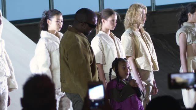 kanye west & daughter north west sings at his show yeezy at celebrity sightings - paris fashion week womenswear fall/winter 2020/2021 on february 24,... - fashion show stock-videos und b-roll-filmmaterial