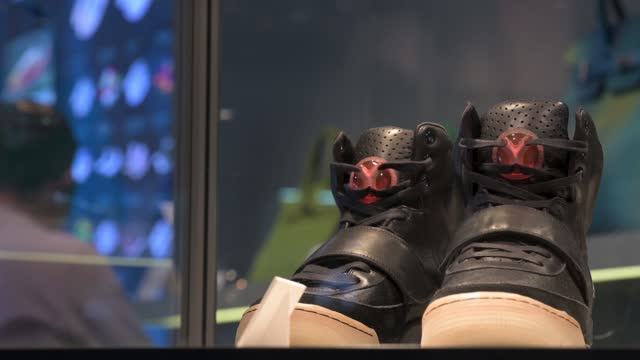 kanye west nike air yeezy 1 sneakers for sale with a price tag of usd 2 million is seen at the world's largest brokers modern collectibles sotheby's... - fashion collection stock videos & royalty-free footage