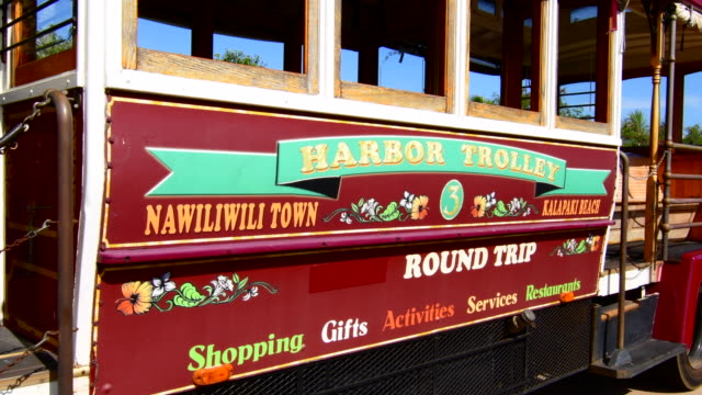 Kapaa Kauai Hawaii downtown village Harbour Trolly bus shuttle for tourists, 4K