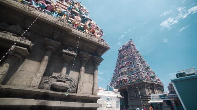 kapaleeswarar hindu temple. dolly shot, steadicam, walking motion - temple building stock videos & royalty-free footage