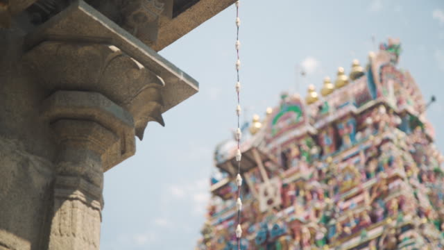 kapaleeswarar hindu temple from outside, defocus people on the foreground - temple building stock videos & royalty-free footage