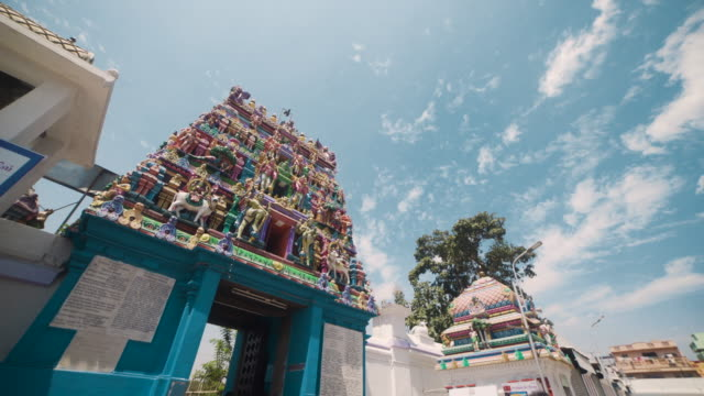 kapaleeswarar hindu temple vimana. dolly shot, steadicam, walking motion - temple building stock videos & royalty-free footage