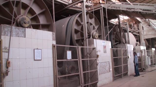 Karachi Pakistan on Wednesday Dec 6 Slip liquid fills a tank in the ball mill department