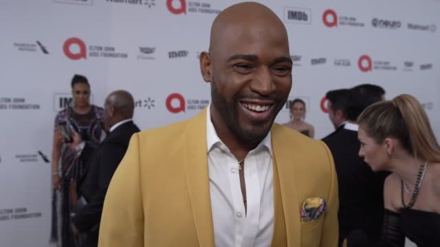 vídeos de stock, filmes e b-roll de karamo brown at the 28th annual elton john aids foundation academy awards viewing party sponsored by imdb, walmart and neuro drinks at the city of... - karamo brown