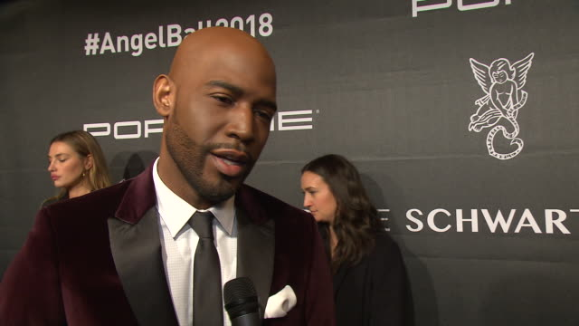 vídeos de stock, filmes e b-roll de karamo brown talks about why this is a cause close to him; his hosting duties for the night and being excited to see michael strahan at the 2018... - karamo brown