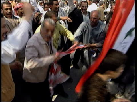 karbala ext gv la gv tgvs local men demonstrating in street led by ba'ath party activists ms american flag burnt cms ms ba'ath party activists making... - carrying stock videos & royalty-free footage