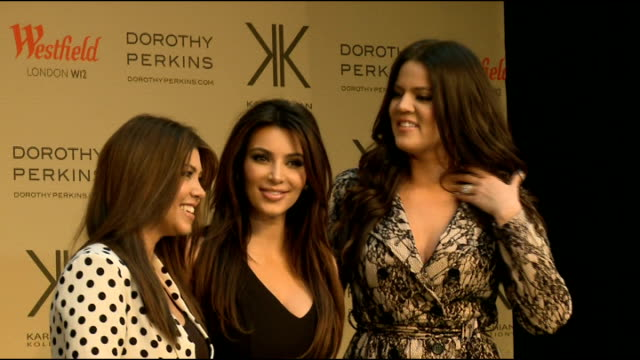'Kardashian Kollection' clothing line launch at Westfield Shopping Centre Kourtney Kardashian Kim Kardashian and Khloe Kardashian posing on stage as...