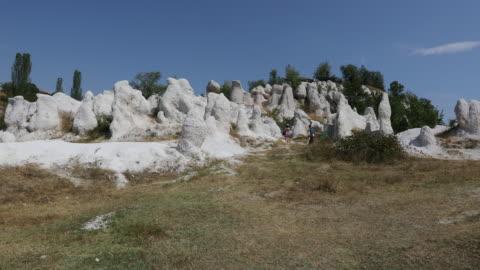 kardzhali, view of the natural landmark called the petrified wedding (the stone wedding). - natural landmark stock videos & royalty-free footage