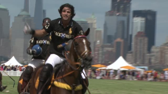kareem rosser nacho figueras and teammates at the fifth annual veuve clicquot polo classic on 6/02/2012 in new york ny united states - 動物を使うスポーツ点の映像素材/bロール