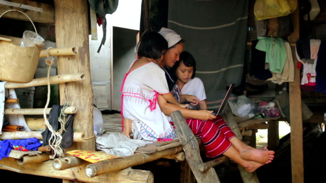 Karen Family learning to use a laptop,Dolly shot