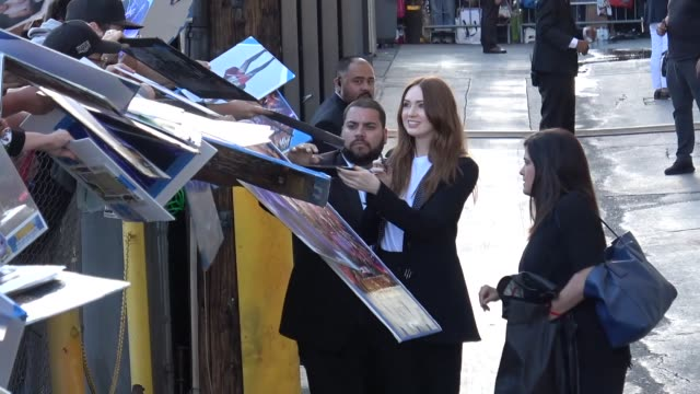 Karen Gillan Sebastian Stan from 'Avengers Infinity War sign autographs for fans outside Jimmy Kimmel Live at El Capitan Theater in Hollywood in...