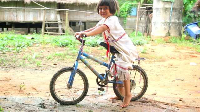 Karen girl poses with her bike