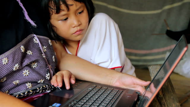 karen girls learning to use a laptop - thai ethnicity stock videos & royalty-free footage