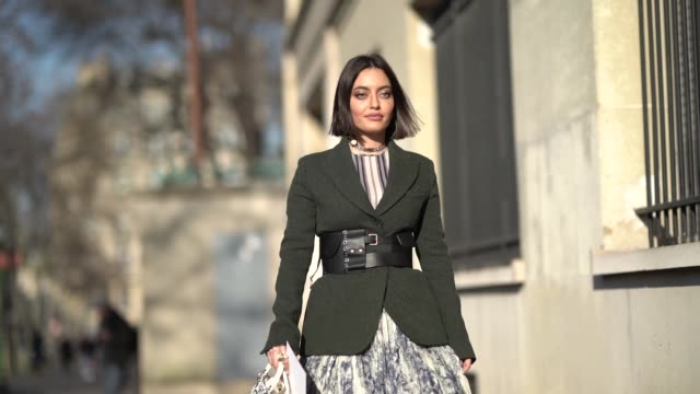karen wazen bakhazi wears a blazer jacket, a large belt, a pleated dress, a lady dior bag, outside dior, during paris fashion week - haute couture... - street style stock videos & royalty-free footage
