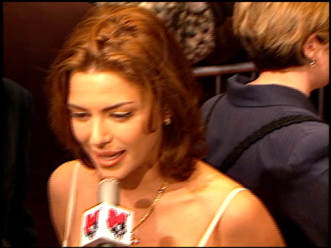 kari wuhrer at the 'anaconda' premiere at the mann village theatre in westwood california on march 15 1997 - レジェンシービレッジシアター点の映像素材/bロール