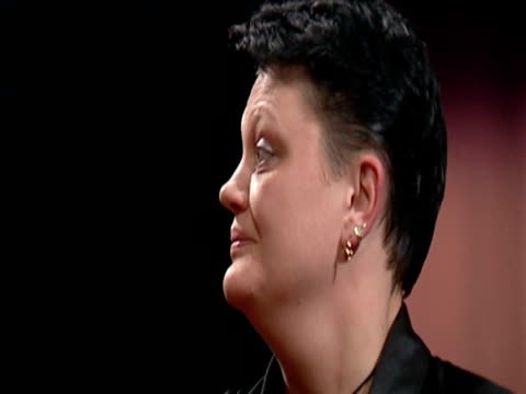 karin krappen throws dart then rolls eyes in dismay and removes darts from board 2003 embassy world darts championships lakeside frimley green - sportlerin stock-videos und b-roll-filmmaterial