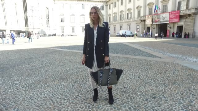 Karin Teigl wearing HM jacket and dress Zara shoes Aigner bag and Topshop glasses is seen during Milan Fashion Week Spring/Summer 2018 on September...