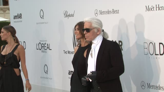 Karl Lagerfeld and Carine Roitfeld at 2012 amfAR's Cinema Against AIDS on May 24 2012 in Cannes France