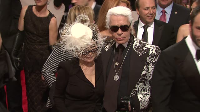 Karl Lagerfeld and Yoko Ono at the 'Alexander McQueen Savage Beauty' Costume Institute Gala At The Metropolitan Museum Of Art at New York NY