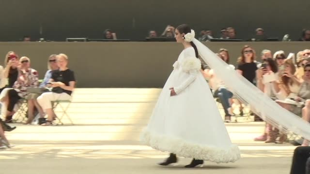 karl lagerfeld presents chanel's autumn winter 2017 haute couture collection under the glass ceiling of the grand palais and a reduced scale replica... - replica eiffel tower stock videos & royalty-free footage