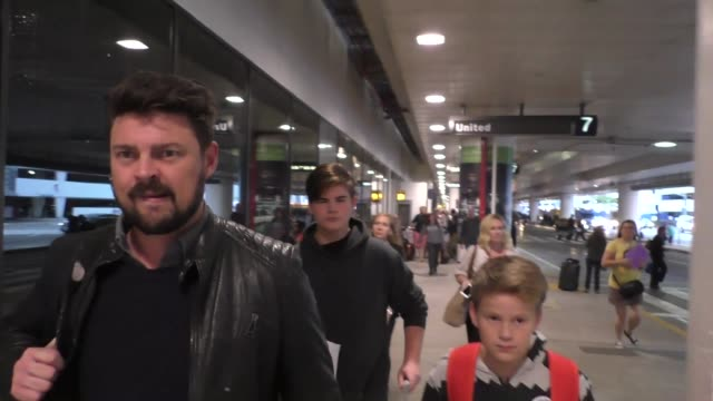 interview karl urban talks about steve adams getting kicked in the groin arriving at lax airport in los angeles in celebrity sightings in los angeles - groyne stock videos & royalty-free footage