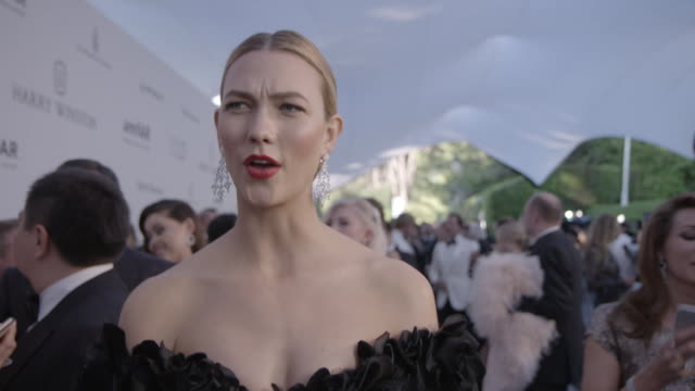 INTERVIEW Karlie Kloss on being at amfAR on the fashion show at amfAR's 23rd Cinema Against AIDS Gala Arrivals at Hotel du CapEdenRoc on May 19 2016...