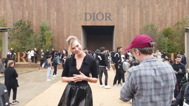 karlie kloss wears a black top, a mesh skirt, mesh boots, outside dior, during paris fashion week - womenswear spring summer 2020, on september 24,... - mesh textile stock videos & royalty-free footage