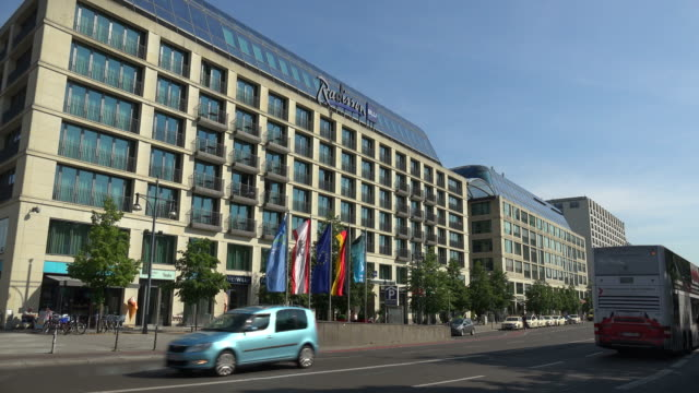 karl-liebknacht-straße and radisson blue hotel, berlin-mitte, germany - hotel stock-videos und b-roll-filmmaterial