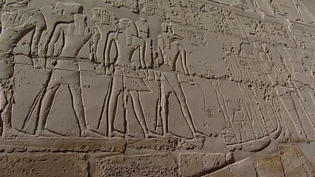 karnak temple complex. pan left on relief of the gods anubis, khnum, horus and seth and pharaoh dragging a boat. - pharaoh stock videos & royalty-free footage